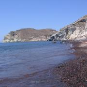 Красно-черный песок и синее море